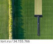 Купить «Green field with disposable shaving machine.», фото № 34155766, снято 28 апреля 2019 г. (c) Ярослав Данильченко / Фотобанк Лори