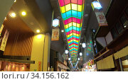 Купить «Slow motion video of the Nishiki Market, the popular food spot, located in Central Kyoto. Japan», видеоролик № 34156162, снято 18 июня 2020 г. (c) Serg Zastavkin / Фотобанк Лори