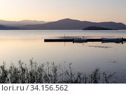 Купить «Panorama of a mountain lake (Macedonia, northwest Greece)», фото № 34156562, снято 26 августа 2017 г. (c) Татьяна Ляпи / Фотобанк Лори