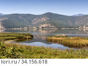 Купить «View of the lake Hemaditida (northwest Greece, Macedonia)», фото № 34156618, снято 27 августа 2017 г. (c) Татьяна Ляпи / Фотобанк Лори