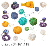 Skein of greenish yellow melange yarn with unwound tail isolated on white background. Стоковое фото, фотограф Zoonar.com/Valery Voennyy / easy Fotostock / Фотобанк Лори