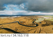 Belarus. Aerial View Of Dry Grass And Partly Frozen Curved River Landscape In Late Autumn Day. High Attitude View. Marsh Bog. Drone View. Bird's Eye View. Стоковое фото, фотограф Ryhor Bruyeu / easy Fotostock / Фотобанк Лори