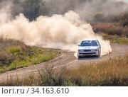 Купить «Summer dry dirt road. Sunny day. Rally car and a lot of dust on a sharp turn.», фото № 34163610, снято 28 июля 2019 г. (c) easy Fotostock / Фотобанк Лори