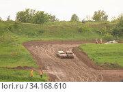 Купить «Traditional rally.The racing car drives into a steep turn, scattering, spraying dirt, dust. Extreme rally», фото № 34168610, снято 10 июля 2020 г. (c) easy Fotostock / Фотобанк Лори