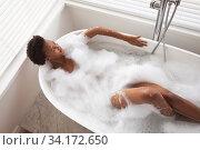 Купить «Woman relaxing in a bathtub», фото № 34172650, снято 17 октября 2019 г. (c) Wavebreak Media / Фотобанк Лори
