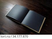 Купить «Blank black book mock up on wooden background. Template for placing your design.», фото № 34177870, снято 9 июля 2020 г. (c) easy Fotostock / Фотобанк Лори