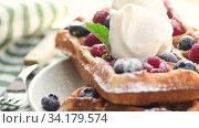 Купить «Belgian waffles on plate with ice cream», видеоролик № 34179574, снято 8 июля 2020 г. (c) Сергей Петерман / Фотобанк Лори