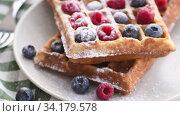 Belgian waffles on plate with berries. Стоковое видео, видеограф Сергей Петерман / Фотобанк Лори