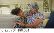 Grandmother embracing her granddaughter at home. Стоковое видео, агентство Wavebreak Media / Фотобанк Лори