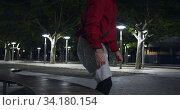 Купить «Sporty Caucasian man training on the street », видеоролик № 34180154, снято 30 мая 2019 г. (c) Wavebreak Media / Фотобанк Лори