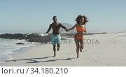 Купить «African American couple running side by side at beach», видеоролик № 34180210, снято 25 февраля 2020 г. (c) Wavebreak Media / Фотобанк Лори
