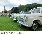 Купить «Hebden bridge, west yorkshire, united kingdom - 4 august 2019: a line of white classic cars and people in the park and people at hebden bridge community annual vintage weekend», фото № 34180854, снято 10 июля 2020 г. (c) age Fotostock / Фотобанк Лори