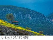 Man resting inside the wooden scenic lookout and shelter in Meteora valley, Trikala region, Greece. Стоковое фото, фотограф Zoonar.com/Pawel Opaska / easy Fotostock / Фотобанк Лори