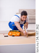 Купить «Young male contractor installing furniture at home», фото № 34187362, снято 11 ноября 2019 г. (c) Elnur / Фотобанк Лори