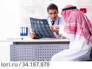 Old male arab visiting young male doctor. Стоковое фото, фотограф Elnur / Фотобанк Лори