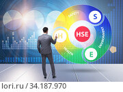 HSE concept for health safety environment with businessman. Стоковое фото, фотограф Elnur / Фотобанк Лори