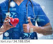 Купить «Young doctor cardiologist in telehealth concept», фото № 34188054, снято 12 июля 2020 г. (c) Elnur / Фотобанк Лори
