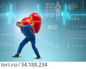 Man doctor in cardiology telemedicine concept. Стоковое фото, фотограф Elnur / Фотобанк Лори