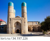 Chor Minor ( Madrasah of Khalif Niyaz-kul),  historic gatehouse for a destroyed madrasa in the historic city of Bukhara, Uzbekistan (2015 год). Стоковое фото, фотограф Куликов Константин / Фотобанк Лори