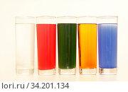 Five Glasses of multicoloured liquid on white background, São Paulo, Brazil. Стоковое фото, фотограф Geff Reis / age Fotostock / Фотобанк Лори
