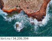 Aerial photo view from above rocky mountain coastline and Mediterranean Sea waters surf sunrise light. Breaking waves raging ocean background. Costa Blanca, Torrevieja shore. Spain. Стоковое фото, фотограф Alexander Tihonovs / Фотобанк Лори