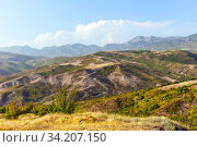 Serpentine mountain road on sunny day. View of the Caucasus Mountains in a sunny day. Стоковое фото, фотограф Евгений Ткачёв / Фотобанк Лори