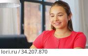 Купить «teenage girl with laptop having video call at home», видеоролик № 34207870, снято 14 июня 2020 г. (c) Syda Productions / Фотобанк Лори