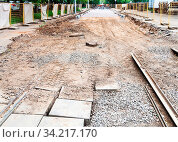 Repair of tram tracks in Moscow city - broken old tram road and laying of new rails on the tram track. Стоковое фото, фотограф Zoonar.com/Valery Voennyy / easy Fotostock / Фотобанк Лори