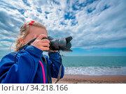 Cute little caucasian girl taking photographs on the seaside in Montenegro. Стоковое фото, фотограф Zoonar.com/Pawel Opaska / easy Fotostock / Фотобанк Лори
