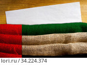 State flag United Arab Emirates of dense fabric with a sheet of aged paper for information. Стоковое фото, фотограф Zoonar.com/art of success / age Fotostock / Фотобанк Лори