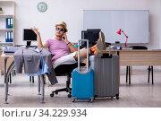 Купить «Young male employee preparing for the trip», фото № 34229934, снято 28 мая 2020 г. (c) Elnur / Фотобанк Лори