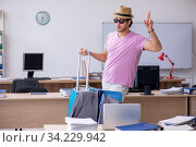 Купить «Young male employee preparing for the trip», фото № 34229942, снято 28 мая 2020 г. (c) Elnur / Фотобанк Лори