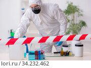 Young male chemist working in medicine lab. Стоковое фото, фотограф Elnur / Фотобанк Лори