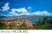 Panoramic image of hillside red tiled rooftop houses on the shore of Lake Ohrid, Northern Macedonia. Стоковое фото, фотограф Zoonar.com/Pawel Opaska / easy Fotostock / Фотобанк Лори