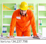 Construction supervisor planning new project in office. Стоковое фото, фотограф Elnur / Фотобанк Лори