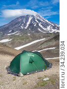 Green tourist tent Red Fox for camping and travel standing in mountain on background of beautiful volcanic landscape - cone of Koryak Volcano (2015 год). Редакционное фото, фотограф А. А. Пирагис / Фотобанк Лори