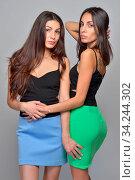 Two beautiful women in summer dresses. Studio portrait. Стоковое фото, фотограф Zoonar.com/© Dmitry Raikin / easy Fotostock / Фотобанк Лори