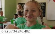 Girl wearing recycle symbol tshirt smiling. Стоковое видео, агентство Wavebreak Media / Фотобанк Лори