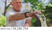 Купить «Close up of senior man stretching his legs in the park», видеоролик № 34246754, снято 16 октября 2019 г. (c) Wavebreak Media / Фотобанк Лори