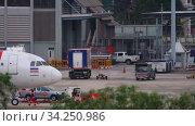 Купить «Airplane Airbus 320 towing», видеоролик № 34250986, снято 28 ноября 2019 г. (c) Игорь Жоров / Фотобанк Лори
