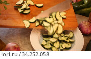 Cooking vegetable salad of cucumbers and tomatoes closeup. Стоковое видео, видеограф Яков Филимонов / Фотобанк Лори