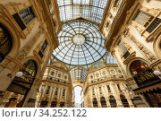 Galleria Vittorio Emanuele II from inside the arcade. View of the glass dome. City of Milan, region of Lombardy, Italy, Europe. (2018 год). Редакционное фото, фотограф Bala-Kate / Фотобанк Лори