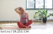 woman doing yoga exercise at studio. Стоковое видео, видеограф Syda Productions / Фотобанк Лори