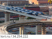 Купить «View of trucks driving over the new Genoa Bridge as part of a static test to examine the robustness of the structure ,Genoa,ITALY-19-07-2020.», фото № 34254222, снято 19 июля 2020 г. (c) age Fotostock / Фотобанк Лори