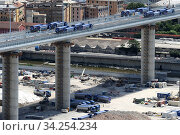 Купить «View of trucks driving over the new Genoa Bridge as part of a static test to examine the robustness of the structure ,Genoa,ITALY-19-07-2020.», фото № 34254234, снято 19 июля 2020 г. (c) age Fotostock / Фотобанк Лори