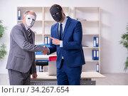 Купить «Two businessmen wearing masks during negotiations», фото № 34267654, снято 19 декабря 2019 г. (c) Elnur / Фотобанк Лори
