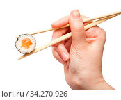 Female hand with disposable chopsticks holds sake maki sushi roll with salmon fish isolated on white background. Стоковое фото, фотограф Zoonar.com/Valery Voennyy / easy Fotostock / Фотобанк Лори