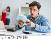 Young couple looking at family finance papers. Стоковое фото, фотограф Elnur / Фотобанк Лори