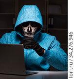 Scary hacker hacking security firewall late in office. Стоковое фото, фотограф Elnur / Фотобанк Лори