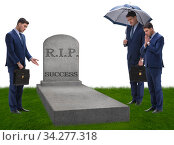 Businessman mourning the death of success. Стоковое фото, фотограф Elnur / Фотобанк Лори